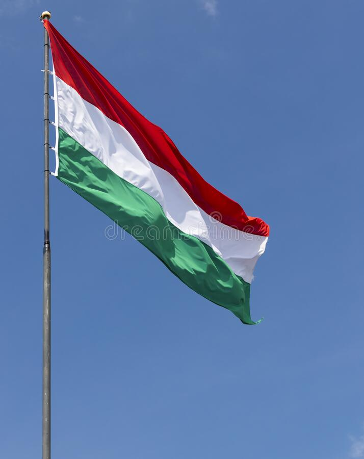 Hungarian flag on blue sky royalty free stock photo