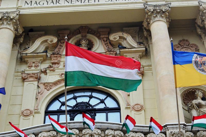 Hungarian Flags outside the National Theatre Pecs, Hungary. Pecs is a city in south western Hungary and is a UNESCO World Heritage sight and was a european royalty free stock images