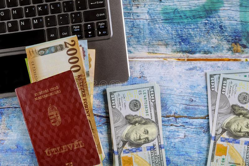 The Hungarian passports with computer keyboard of various stack of money US dollar bills and Hungarian banknotes forints royalty free stock photography