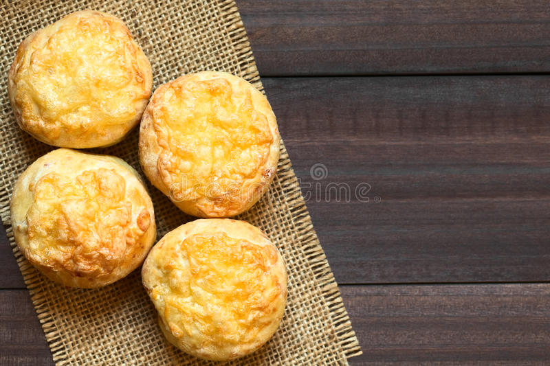 Hungarian Pogacsa Savory Pastry. Hungarian traditional Cheese Pogacsa savory baked bread-like pastry, photographed overhead on dark wood with natural light ( stock photography