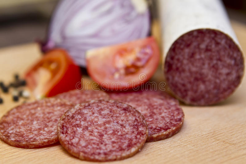 Hungarian salami. With tomato onion peppers stock photography