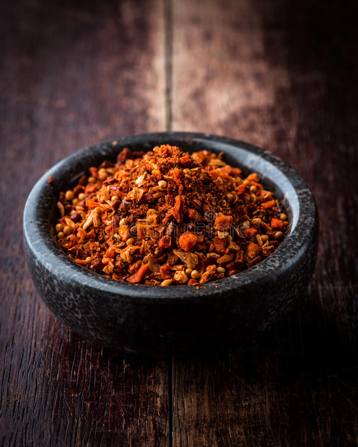 Hungarian spice mix in stone bowl stock photography