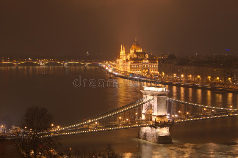 Hungary, Budapest, Chain bridge and Hungarian Parliament Building - night picture. Beautiful lights and reflections in Danube river royalty free stock photo