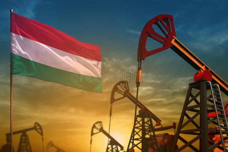 Hungary oil industry concept. Industrial illustration - Hungary flag and oil wells against the blue and yellow sunset sky. Hungary oil industry concept royalty free stock photos