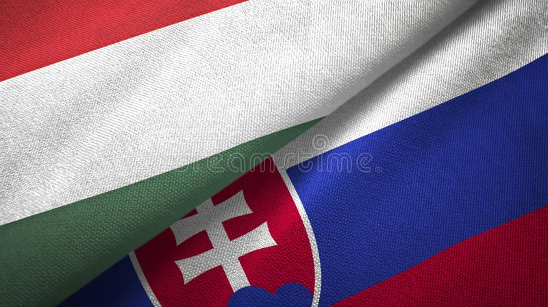 Hungary and Slovakia two flags textile cloth, fabric texture. Hungary and Slovakia flags together textile cloth, fabric texture royalty free illustration