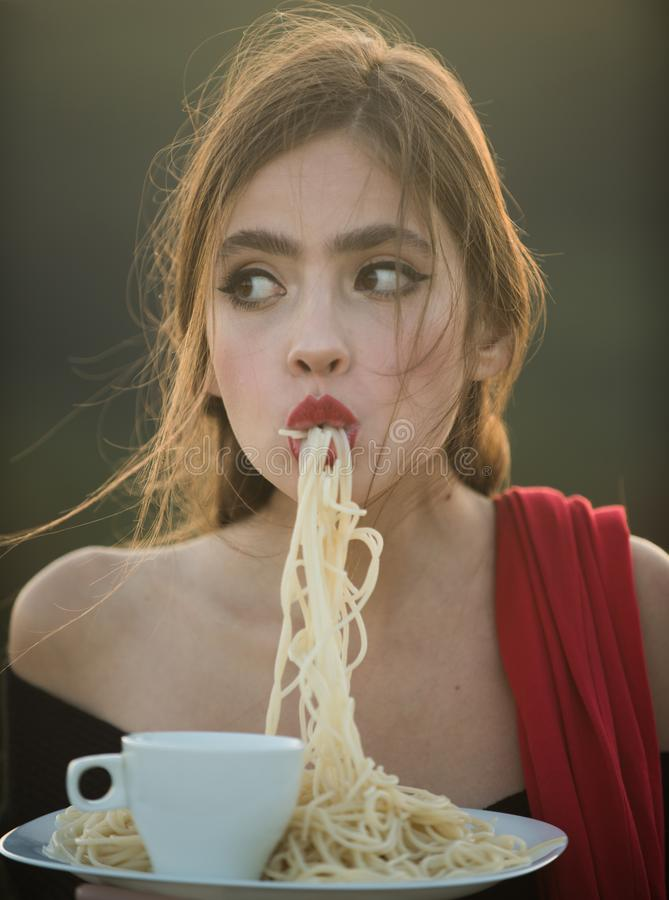 Hunger, appetite, recipe. hunger and appetite of young woman with red lips eating dinner stock photo