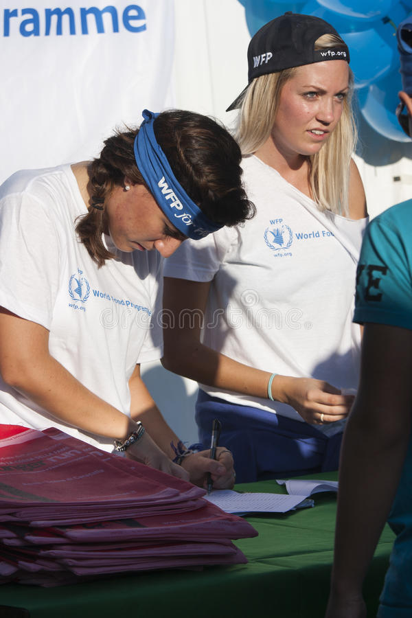 Hunger Run (Rome) - WFP - Two girls at the bench of the inscriptions. The HUNGER RUN – a 10k competitive race and a 5k fun run/walk - 19 October 2014 royalty free stock image