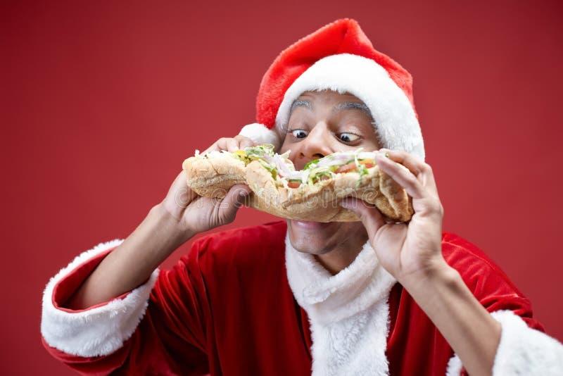 Hungriga Santa arkivbild