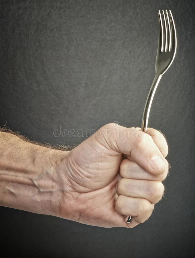 Free Hungry And Angry Male Hand Holding Fork Stock Images - 45130794