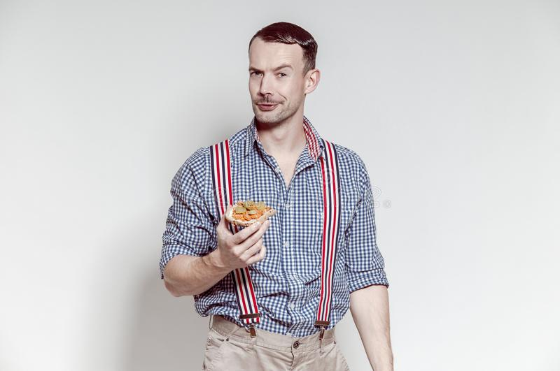 Hungry Bavarian man eating sandwich stock photos