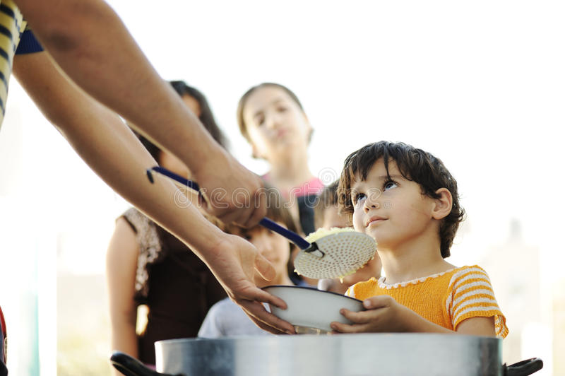 Hungry children in refugee camp stock photos