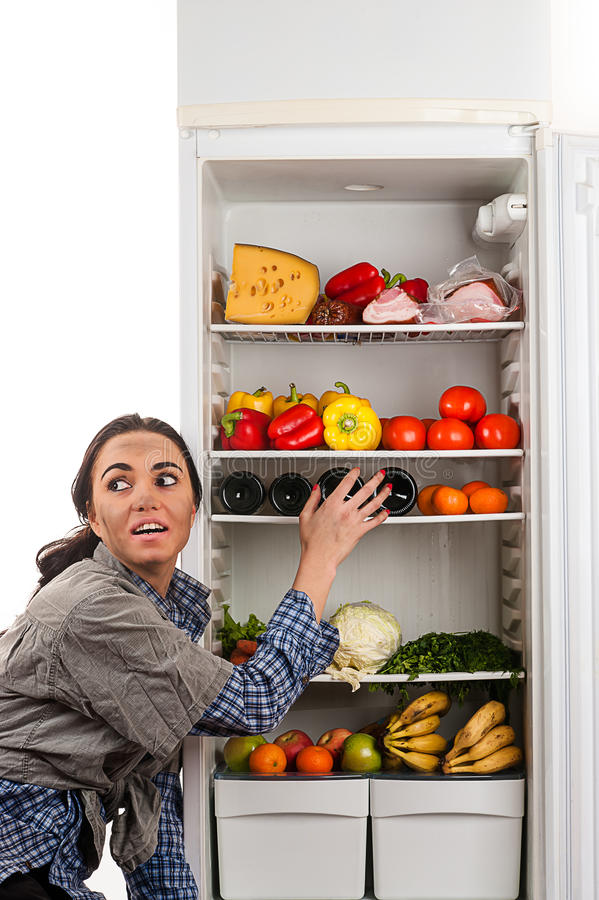 Hungry dirty woman stealing food stock image