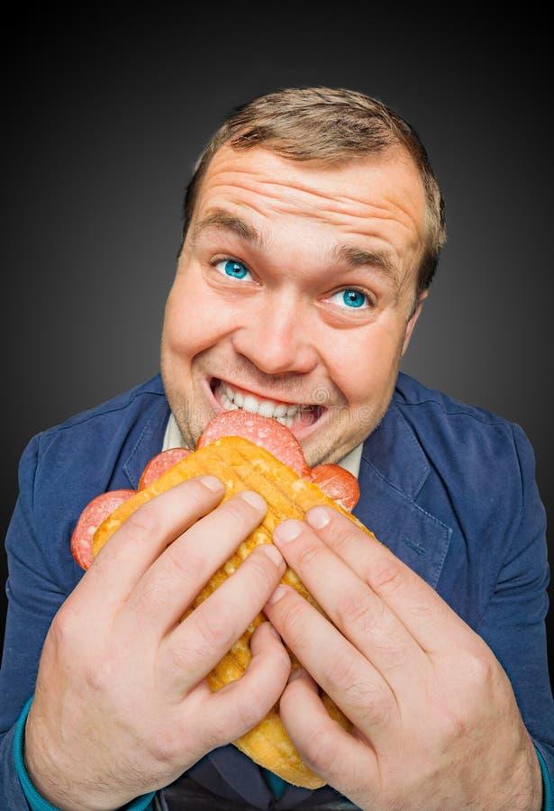 Hungry fat man stock photos
