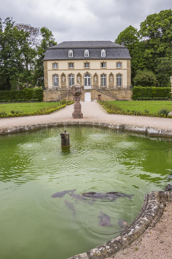 The always hungry fish in the fountain in front of the Orangery in Echternach, Luxembourg. The always hungry fish in the fountain in front of the Orangery in royalty free stock photo