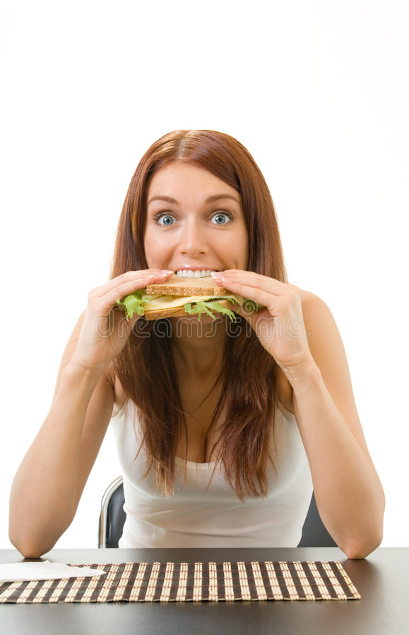 Hungry gluttonous woman eating. Sandwich with cheese, isolated royalty free stock photography
