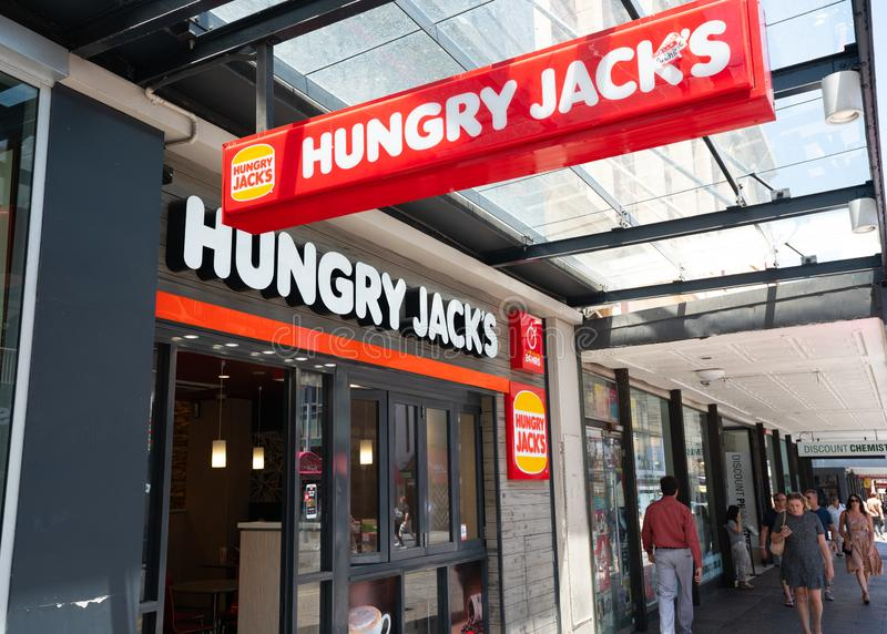 Hungry Jack`s restaurant entrance with logo an Australian fast food franchise in Adelaide Australia royalty free stock photography