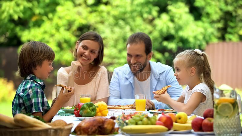 Hungry kids eating delicious pizza, childrens favorite food, italian cuisine royalty free stock image