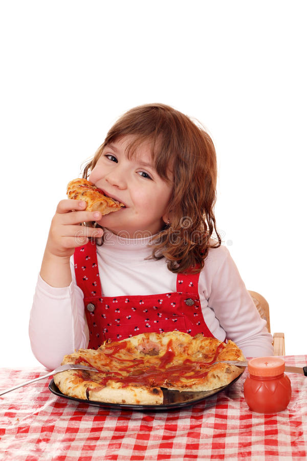Little girl eat pizza. Hungry little girl eat pizza stock photography