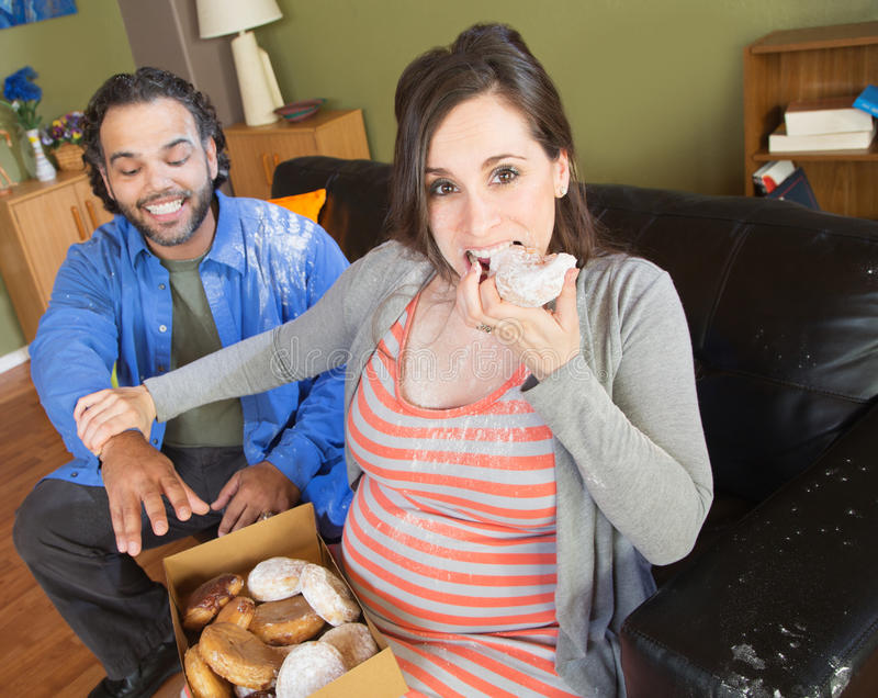 Hungry Pregnant Couple royalty free stock image