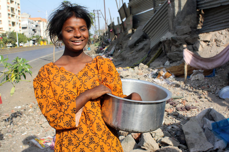 Hungry Streetside Teenager. A poor Indian streetside hungry teenager showing her empty vessel royalty free stock photos