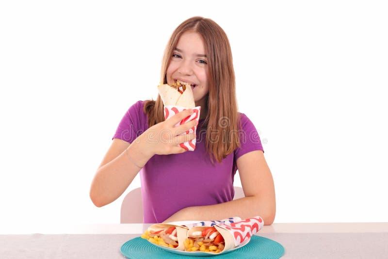 Hungry teenage girl is eating gyros stock photos