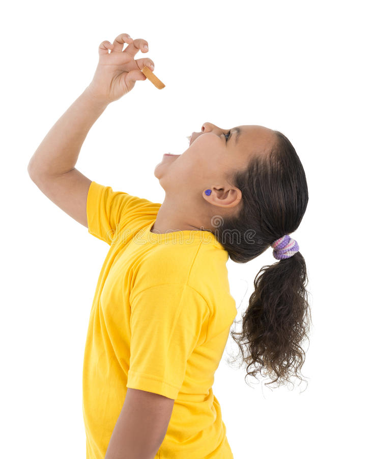 Download Hungry Young Girl Eating Biscuit Stock Image - Image: 42022569