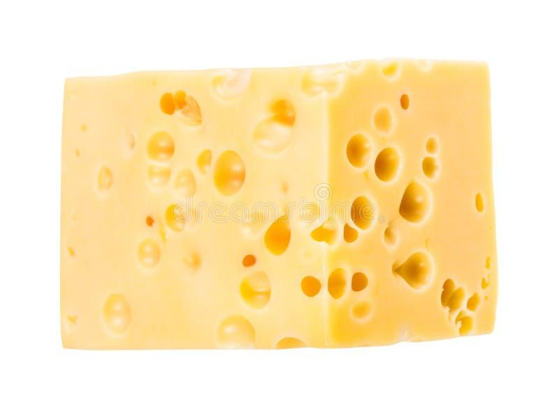 Hunk του κίτρινου ελβετικού τυριού με τις εσωτερικές τρύπες στοκ φωτογραφία με δικαίωμα ελεύθερης χρήσης