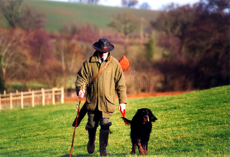 The Hunt. Hunter & dog returning after a shoot
