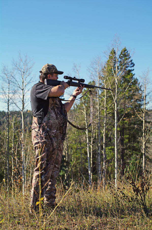 Download Hunter stock image. Image of tree, hunter, shooting, forest - 17950165