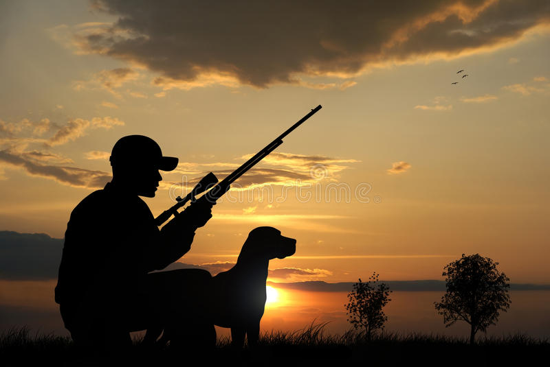 Hunter. With his dog silhouettes on sunset background