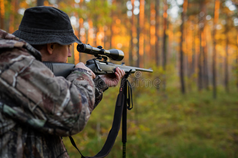 Hunter aiming with rifle royalty free stock images