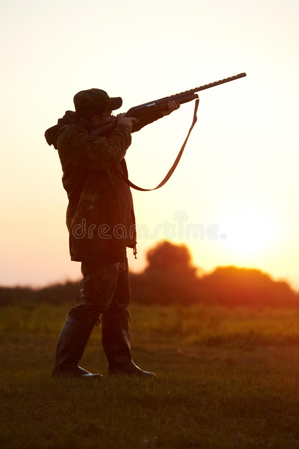 Hunter aiming with rifle gun royalty free stock images