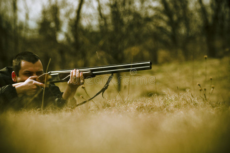 Hunter Aiming Shotgun stock photos