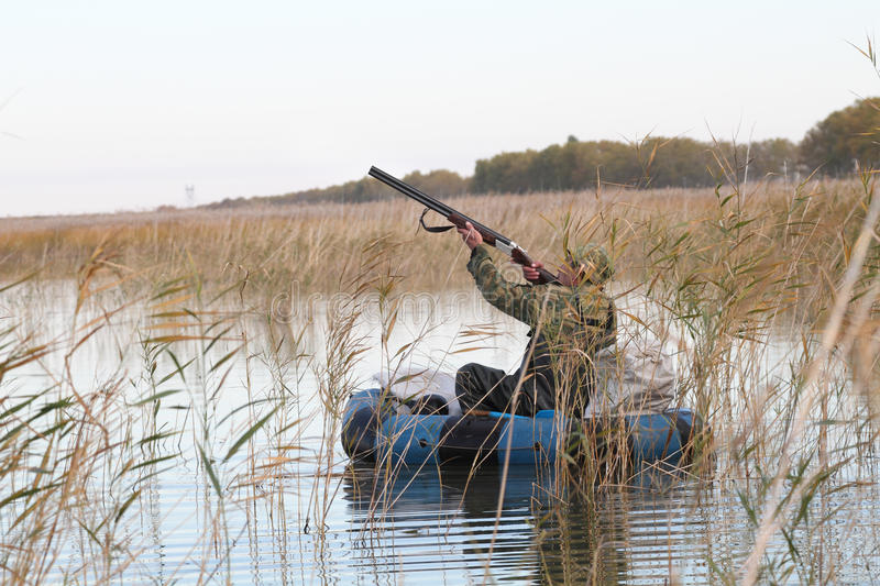 Download Hunter In A Boat Royalty Free Stock Photo - Image: 26972265