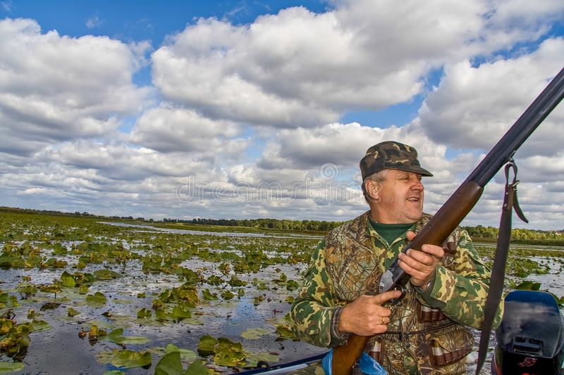 A hunter hunts ducks royalty free stock images