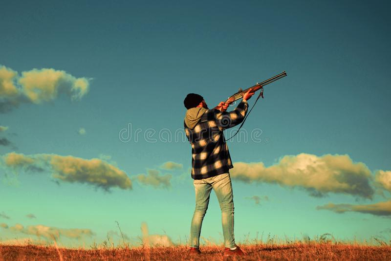 Hunter in the fall hunting season. Hunter with shotgun gun on hunt. Skeet shooting. stock images