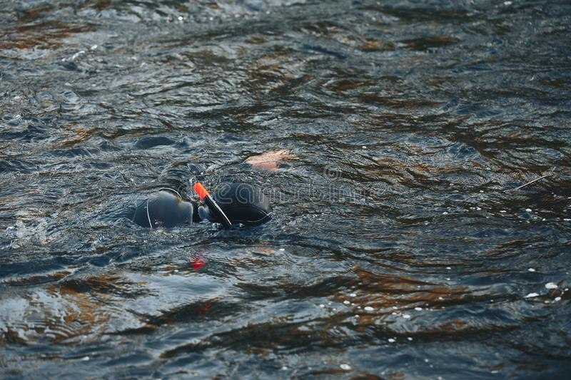Hunter Fisherman in Wetsuit with a Speargun Looks Under the Water in Search of Fish stock photos