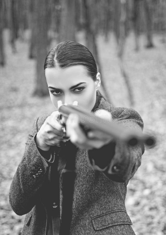 A hunter with a hunting gun and hunting form to hunt. Hunter woman. Hunter with a backpack and a hunting gun. Black and. White stock image