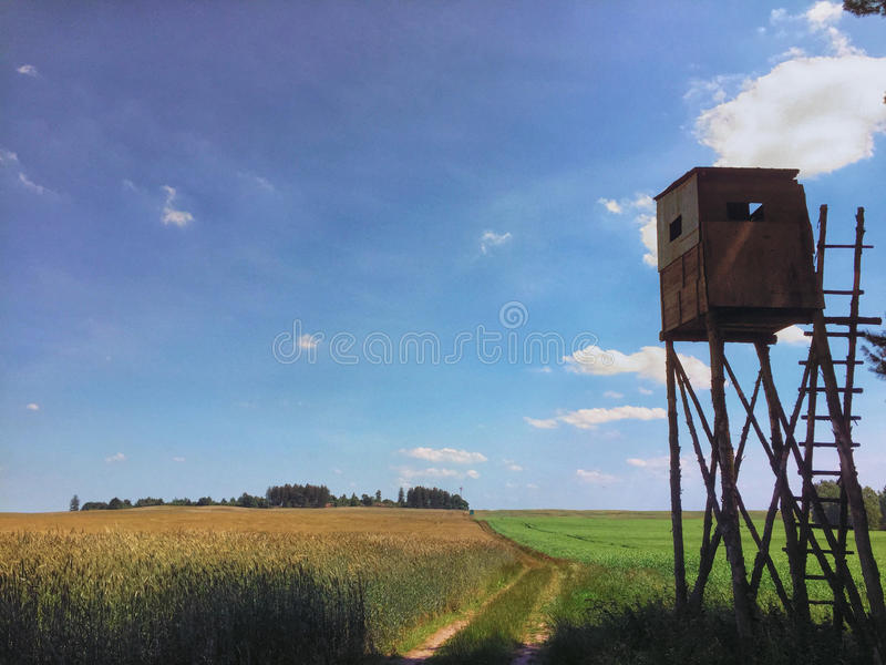 Hunter lookout tower in a field royalty free stock photography