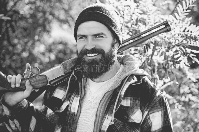 Hunter man holding gun and smile. Hunter with long beard on hunt. Barbershop vintage. Ideas about Barber shop and Barber stock photos