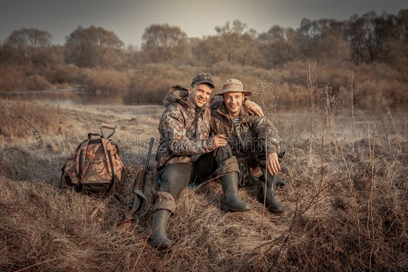 Hunter men friends recreation rural field hunting period symbolizing strong friendship royalty free stock image