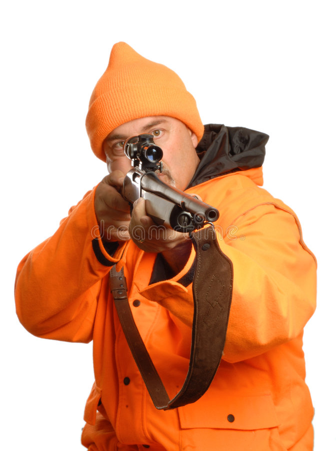Hunter pointing gun. Hunter pointing rifle in blaze orange gear stock image