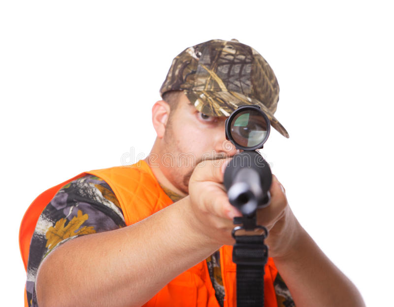 Hunter pointing the gun towards the camera. With eye in the scope stock photography