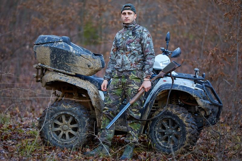 Hunter on quad bike stock photography