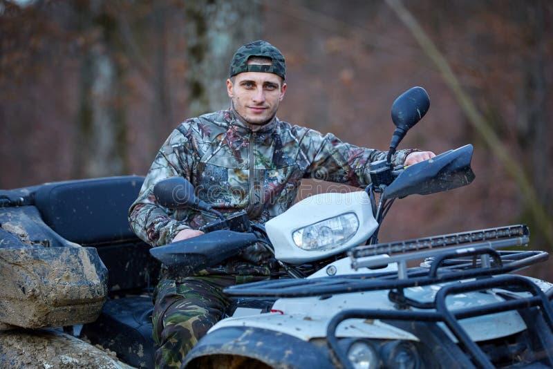 Hunter on quad bike stock image