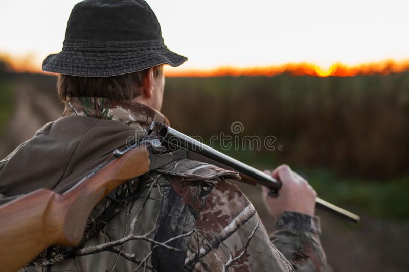 Hunter with rifle over his shoulder royalty free stock photos