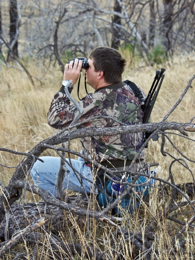 Hunter Scouting With Binoculars Stock Photos