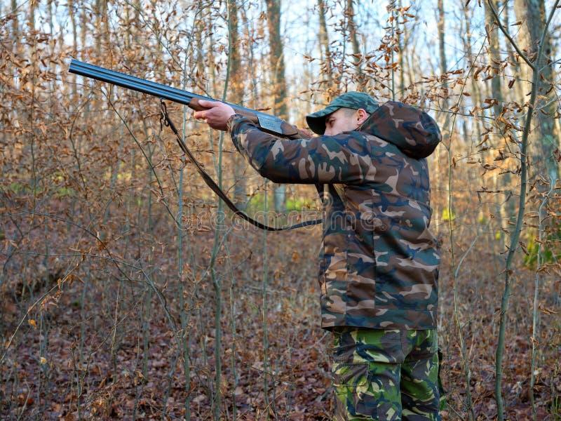 Hunter with shotgun stock images