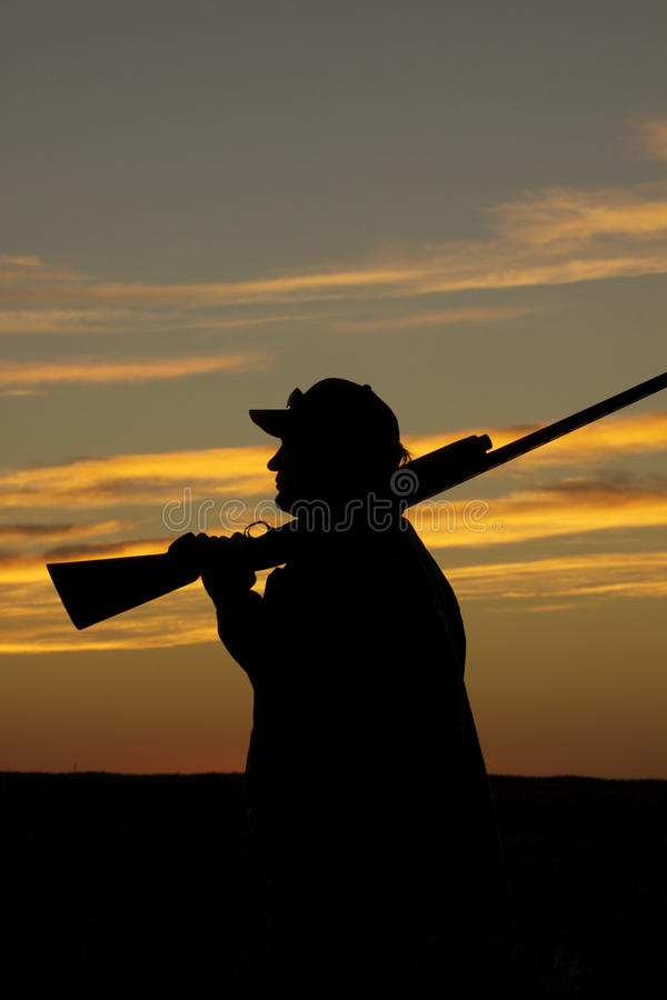 Hunter With Shotgun In Sunset Royalty Free Stock Photography