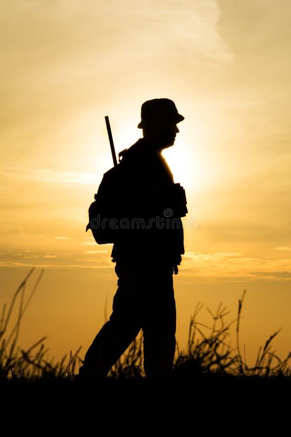 Hunter With Shotgun In Sunset Royalty Free Stock Photo